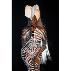 Grace Jones and her outrageous outfits at the Hammerstein Ballroom in New York City--she has inspired a lot of today's artist!!