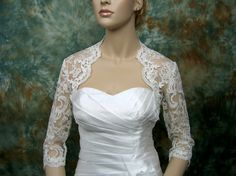 3/4 sleeve bridal shrug re-embroidered lace bolero wedding bolero jacket bridal bolero bridal jacket- Available in ivory and white. $79.99, via Etsy.