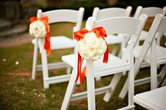 White pomanders with Orange bows