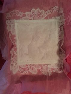 I made this handkerchief out of my wedding dress for my daughter to use as her something old.  It is also a great keepsake for her.