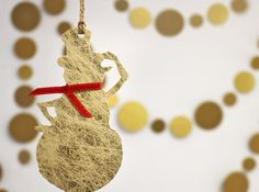 This shiny funny Snowman christmas tree ornaments can be a perfect gift for friends & family! They have solid chipboard base, covered with glossy gold paper with fine white fibers, decorated with red satin ribbon and piece of craft twine so they can be attached on the tree. You can easily write down your message on the back or just leave it blank with stamped label and use them as Gift tags.  Available with 3 labels on the back side: Peace and Joy Happy New Year Let it Snow  Approx. size…