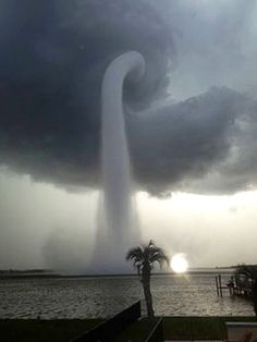Joey Mole was in his home in Tampa, Florida when a massive waterspout erupted from the bay in front of him. The spout, which looked like something from a Sci-Fi horror movie, spiraled down from a cloud hovering over Old Tampa Bay (Oldsmar), sucking water up into the sky.  http://www.imaging-resource.com/news/2013/07/11/photographer-captures-incredible-image-of-massive-waterspout-towering-over