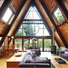 The triangular shape adds a nice touch : CozyPlaces A Frame House Plans, A Frame Cabin, Style At Home, Cabin In The Woods, Cozy Cabin, Home Fashion, Cottage Style, My Dream Home, Future House