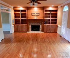 The cookie-cutter setup in this living room (those built-ins have to to be in about 2.5 million homes, right?) left a void for any personalization. Wood floors and wood built-ins was a little too much of a good thing./
