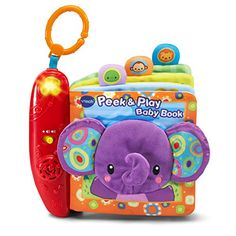 The Peek & Play Baby BookTM by VTech is a real page turner! The soft book pages introduce adorable animals through bold pictures and fun interactive features. The cover has a cute elephant with crin. Will Turner, Pop Up Tv Cabinet, Vtech Baby, Toys For 1 Year Old, Best Kids Toys, Thing 1, Toddler Dolls, Bunny Toys, Cute Elephant