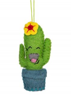 Don't be afraid to touch this sweet cactus - it's handcrafted from felt! The fair trade Joyful Cactus Ornament is handmade by artisans working with the Association for Craft Producers in Kathmandu, at the foot of the Himalayas. The felt used to make this ornament is dyed using AZO-free dyes. The workshop is incorporating innovative processes to protect the environment. Their office runs partially off solar power, and they have reduced their fuel consumption by fifty percent.
