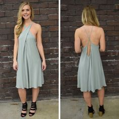 This mint, shift happens to be one an employee favorite! We love the midi length and super cute criss-cross detailing! -  $54 #springfashion #spring  #fashionista #shoplocal #aldm #apricotlaneboutique #apricotlanedesmoines #shopaldm #desmoines #valleywestmall #fashion #apricotlane #newarrival  #shopalb  #ootd #westdesmoines  #shopapricotlaneboutiquedesmoines #ontrend #mint #shiftdress #mididress