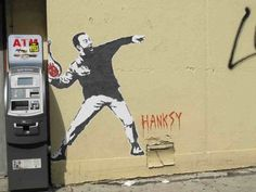 """Cast Away Hanksy, A Street Art Parody of Banksy  BY SCOTT BEALE ON AUGUST 23, 2011  Bowery Boogie spotted a new Hanksy street art in NYC's Lower East Side. This one is a Cast Away version of Tom Hanks throwing """"Wilson"""" instead of flowers, which appears to be a reference to this Family Guy scene.    Previously we have featured a rat version of Hanksy and a Catch Me If You Can version of Hanksy.  via Wooster Collective  photo via Bowery Boogie"""