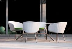 The Shell Chair outdoor dining chair is characterized by the rounded 'Shell' shaped seats, which gives the seating elements an encapsulating, comforting and sheltered feel, ideal for on a nice terrace at a restaurant viewing the ocean. #retrodesign