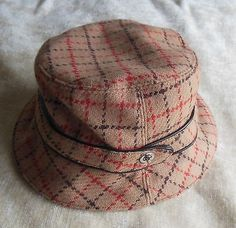 Coach Women's Wool/Leather Trim Plaid Bucket Hat  100% Wool  Leather Trim  Size M/L  Return Policy All returns accepted within 14 days of receiving item(s)  You must return an item in the same condition as it was received, not used or altered i...