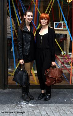 Two girls with bold black outfits