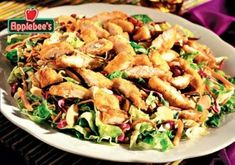 Applebee's Oriental Chicken salad...I can control the amt of lettuce vs cabbage & size of the shred.  Luv the dressing.