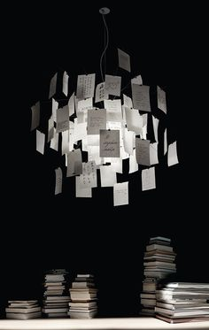 One of the key features of this chandelier is that it's completely customizable. There are 80 pieces of paper attached to the chandelier with paper clips.