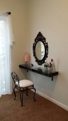 My awesome vanity! Mirror, shelf, and brackets came from ikea. Chair is from homegoods. :)