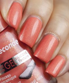 <3 Bourjois Corail Magique. It's a peachy/coral shade with gold flecks.