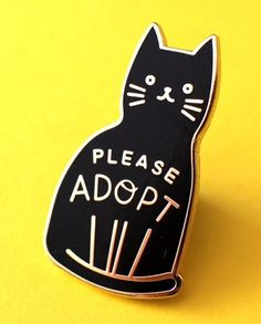 A pin with the gentle reminder to always adopt your furrever friend.