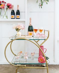Want to add a bar cart to your home but don't know where to start? You've come to the right place! Bar carts are a huge trend that we are certainly on board with, but it can be hard to find out exactly what to add to your bar cart or how to even start… Home Bar Decor, Bar Cart Decor, Home Design, Home Interior, Interior Decorating, Interior Design, Bar Cart Essentials, Bar Refrigerator, Home Bar Areas