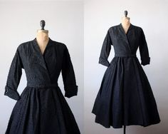 1950's black diamond wrap dress  Stunning vintage 1950's dress that's perfect for any season. Rich, black textured material with a flattering wrap bodice and fully flared skirt. 3/4 length sleeves that end in four diamond-like buttons. Comes with a matching belt.    Flattering, feminine cut.