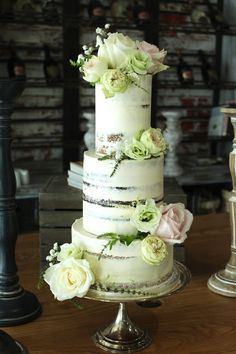 Three tier semi-naked wedding cake.  www.cakesbyyolk.com