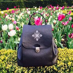 Our dear Puffin loves flowers and good vibes. #iutta #leather #backpack #birdinspace  #embroidery #design #joyofwearingiutta #vibes #spring