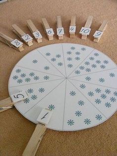 For practice counting and assigning the # to the amount. Do again and again by sweeping up the snowflakes (or whatever is used) and dropping them where they fall.  (Although if it's random there might be two of the same number in which case you'd have to have more clothespins.)