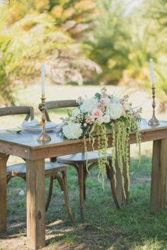Farm Table Sweetheart Table - Floral Centerpiece by Flower Girl Designs - Vintage Rustic Wedding Inspiration - Central Florida Wedding Venue - Vintage Lace Dress from Casa di Bella - Photographer: Ashley Jane Photography - Click pin for more - www.orangeblossombride.com