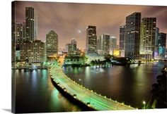 Solid-Faced Canvas Print Wall Art Print entitled Bridge leads across waterway to downtown Miami sklyine at night. Yosemite National Park, National Parks, The World Is Flat, Miami Skyline, Downtown Miami, Ways Of Seeing, Shutter Speed, Aerial View, Places To Travel