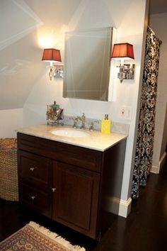 pretty bathroom! I like the double light fixture around the mirror