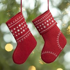 Stuff this generously sized stocking ornament with a small gift or candy.  Each red felt sock is embroidered with stars and scrolls in contrasting white.  Makes a clever presentation for holiday flatware or a gift card. Wool feltSynthetic threadSpot cleanMade in India.