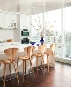 wood barstools in white kitchen