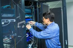 IT Technician With Server Cables Royalty Free Stock Photo