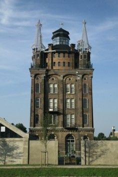 industrial heritage, watertower current Villa Augustus, Dordrecht, the Netherlands Tower Building, Church Building, Building Art, Lake Como Villas, Medieval Tower, Unusual Homes, Unique Buildings, Urban Setting, Out Of This World