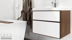 This vanity features two drawers or one extra-deep drawer with push-to-open glides. (WETSTYLE: Frame Collection: Vanity Metro)