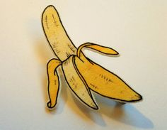 Made with shrink plastic, this brooch is made with an original illustration of a banana.