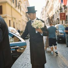 The bellman at Hotel de Russie in Rome assisted the bride with her all-white clutch of blooms as she stepped into the car to head from the hotel to her ceremony site for this destination wedding. | Bob Gail Events #destinationwedding Cigarette Girl, Different Types Of Flowers, Real Weddings, Destination Weddings, White Clutch, Roman Holiday, Magical Wedding, Wedding Weekend, Groom And Groomsmen