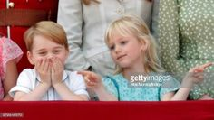 Prince George of Cambridge and Isla Phillips stand on the balcony of Buckingham Palace during Trooping The Colour 2018 on June 9 2018 in London...
