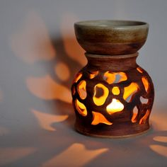 Handmade ceramic oil burner with carved flowers. A fab gift for only £24. Available in our online gift shop www.purrfect-ceramics.co.uk