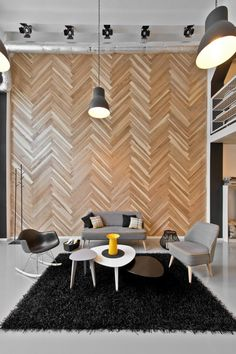 The white color of the walls vivid black-painted brick motifs. Gray glossy epoxy floor provides space and tree-roofed with solid wood boards on wall - comfort.