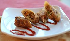 Italian Sausage Egg Rolls: Perfect for entertaining, these Italian-inspired egg rolls with fresh Uncle Charley's sausage can be fried or baked to optimal deliciousness. #Appetizers #Snacks #Recipe #Recipes #Sausage #EggRoll