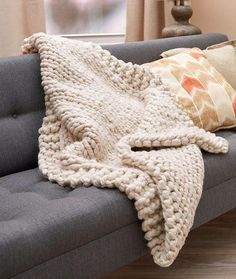 Can't you picture yourself curling up by the fire with this amazingly chunky knitted blanket pattern?