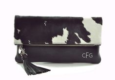 cow hide clutch bag poppy lomdon