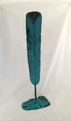 Green patinated Huia Feather .. Brett Rangitaawa, 2015 ..In traditional Māori thought, many birds were seen as chiefly. The feathers of certain birds were used as adornment for high-born people – particularly plumes worn in the hair. Chiefs wore the kahu huruhuru (feather cloak), made from the feathers of the most beautiful birds. Huia feathers were highly prized treasures and were worn by those of high rank .. Enquire to purchase