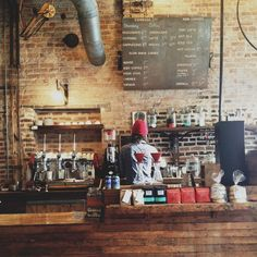 wooden coffee counter at The Hub in Springfield, Mo. Incredible coffee shop + bike shop http://insidethehub.com/