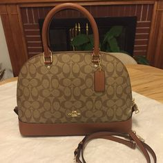 Brand new Coach Saddle Bag Brand new tan and brown, Coach Saddle bag, tags on, light weight, perfect for spring, comes with long strap. Coach Bags