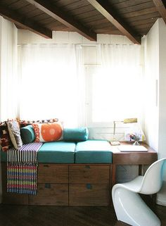 Reading nook. Stacked shelving. Side table/writing desk. Wall between front door & closet.