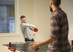 Ryan and Kyle test out the new location of the ping-pong table. Photo by Elijah Tiegs