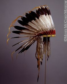 Eagle feather headdress, Northern Plains, Assiniboine or Nakoda. Circa Only worn by men as a rule with each feather having to be earned before the earner could wear them. Such headdresses were honors that were not limited to so-called Chiefs. Native American Headdress, Native American Clothing, Native American Artwork, Native American Beauty, Native American Artifacts, American Indian Art, Native American Indians, Native Indian, Native Art