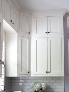 make the kitchen appear taller by installing cabinets all the way up to the ceiling. Finishing Touches to Make or Break a Remodel | Home Remodeling - Ideas for Basements, Home Theaters & More | HGTV
