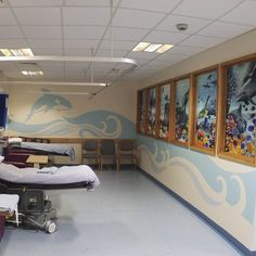 The panels are semi-transparent and printed on internal windows that separate treatments areas in the clinic. Art by Amanda Turner. Pintsizeart.com
