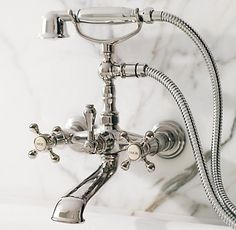 Lugarno Collection from Restoration Hardware with hot/cold labels on taps
